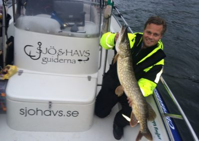 111cm och glad fiskare